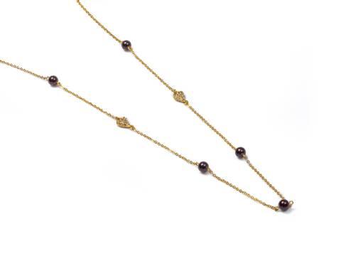 Bilde av 10665 Langt smykke gullfarget sorte perler